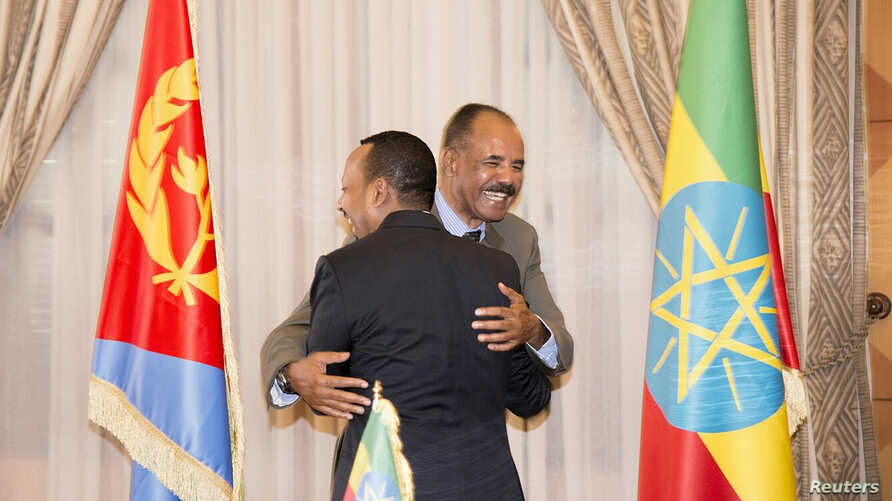 Ethiopian Prime Minister Abiy Ahmed and Eritrean President Isaias Afwerk embrace at the declaration signing in Asmara, Eritrea, July 9, 2018, in this photo obtained from social media. (Ghideon Musa Aron Visafric/via Reuters)