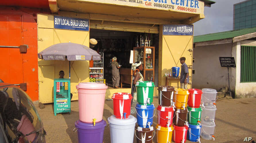 According to local reports the sale of water buckets has increased dramatically, because they are used by Liberian people to fill with disinfectant and to wash their hands to prevent the spread of the deadly Ebola virus,  in the city of Monrovia, Lib...