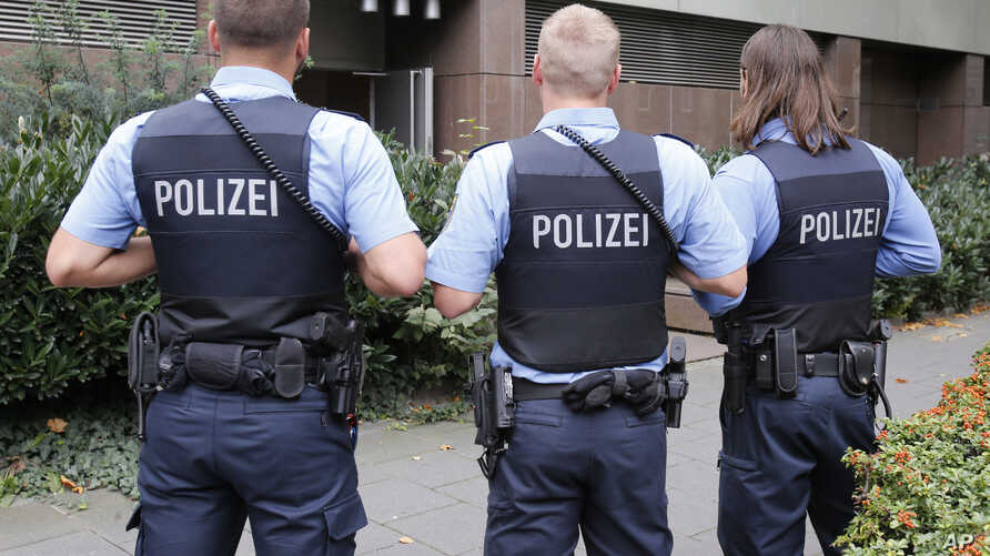 FILE - German police officers  guard outside the regional court in Frankfurt, Germany, Sept.15, 2014.