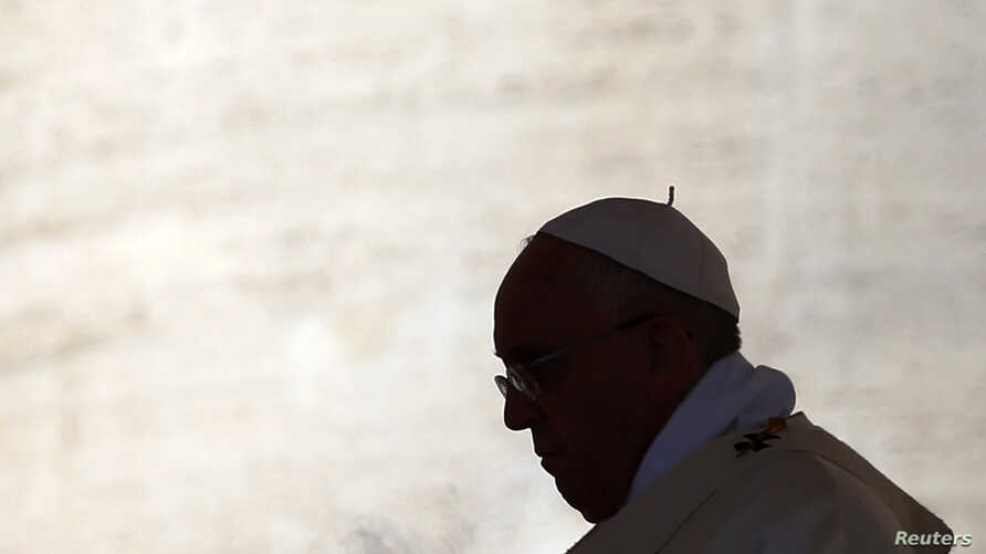 Pope Francis celebrates a mass in Saint Peter's square at the Vatican, Sept. 28, 2014.