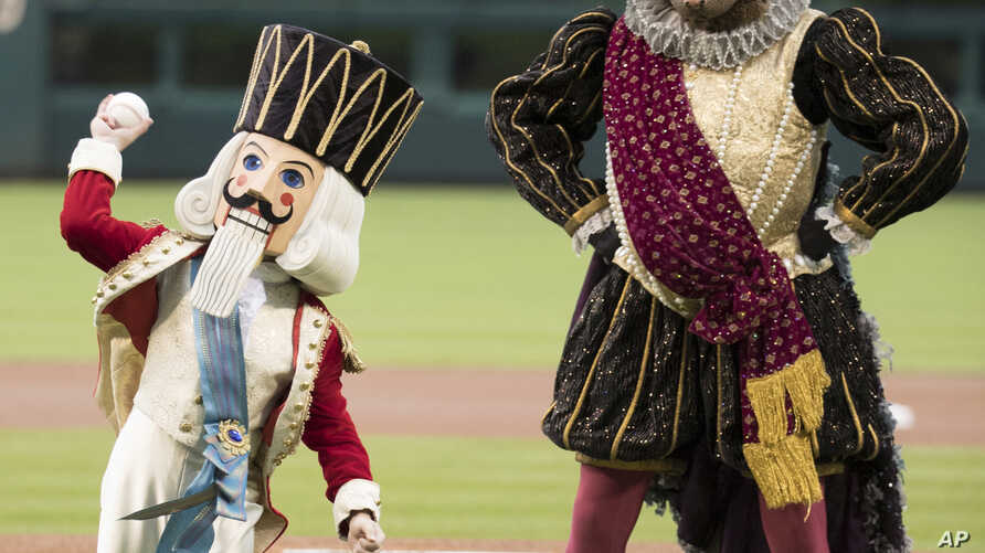 The Prince and Mouse King from the Nutcracker throw out the first pitch prior to the first inning of a baseball game between the Houston Astros and the Philadelphia Phillies, July 25, 2017.