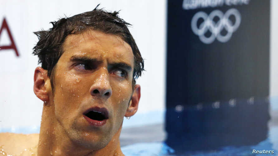 a68e167ef4 Michael Phelps of the U.S. reacts after finishing in fourth place in the  men's 400m individual