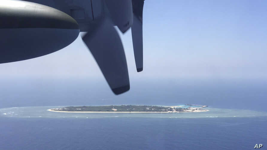 FILE - In this March 23, 2016, file photo, an aerial view is seen from a military plane carrying international journalists of the Taiwan-controlled Taiping island, also known as Itu Aba, in the Spratly archipelago, roughly 1600 kms. (1000 miles) in t