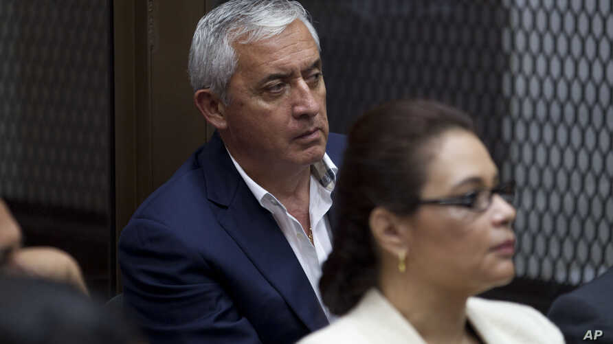FILE - Guatemala's former President Otto Perez Molina, and his former Vice-President Roxana Baldetti, listen during their court hearing in Guatemala City, May 6, 2016. Twenty-three people were arrested Thursday on charges related to the alleged illeg