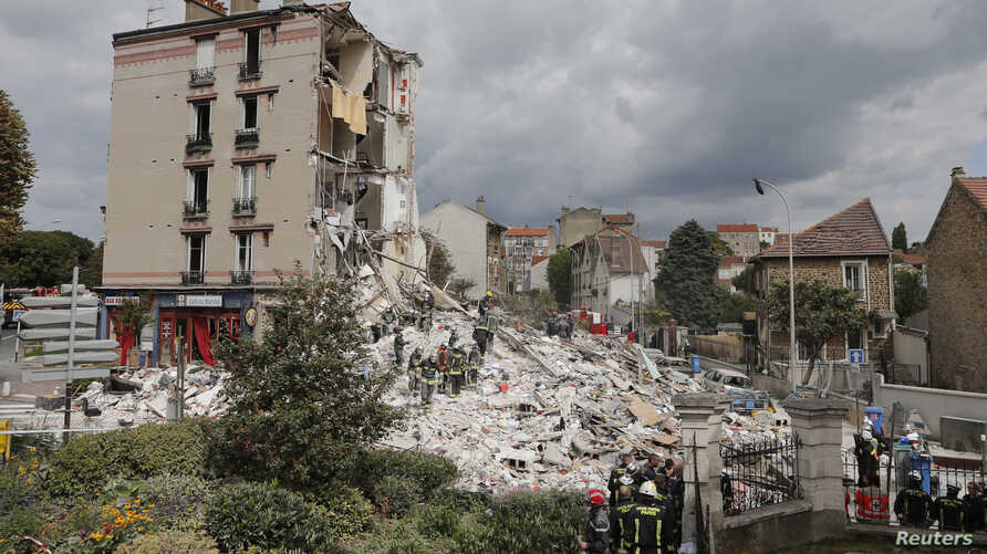 French firefighters search the rubble of a collapsed four-story building in Rosny-Sous-Bois, near Paris, Aug. 31, 2014.