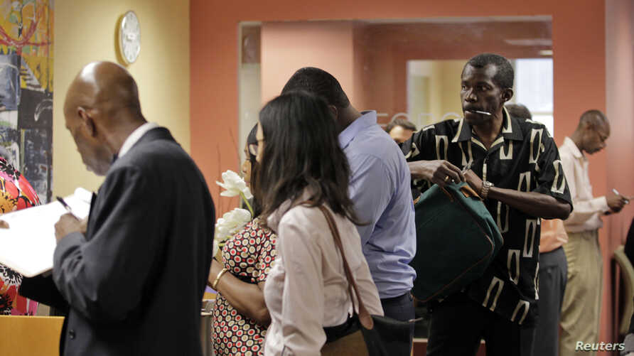 People wait in line to meet with job counselor during a job fair at Workforce1 in New York, September 6, 2012.