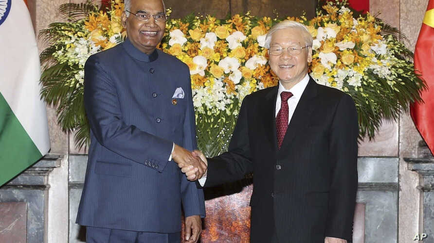 Indian President Ram Nath Kovind, left, shakes hands with Vietnamese President Nguyen Phu Trong before heading for talks behind closed doors in Hanoi, Vietnam, Tuesday, Nov. 20, 2018.