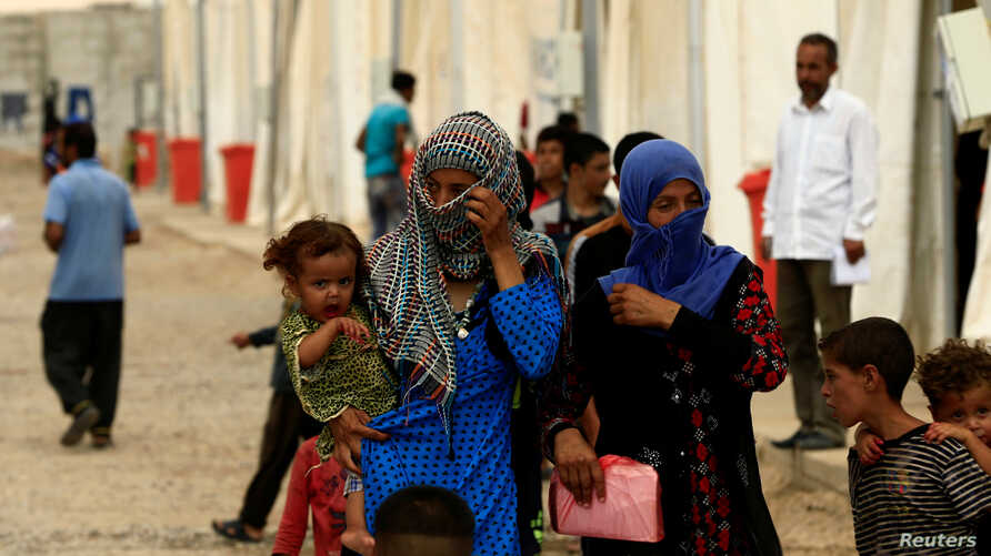 Displaced people, who fled from homes are seen at Hamam al-Alil camp south of Mosul, Iraq July 13, 2017.