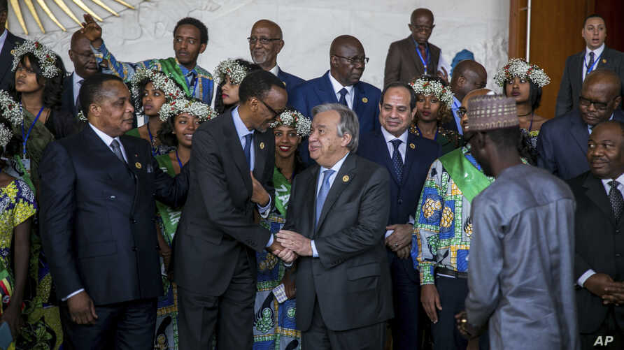 United Nations Secretary-General Antonio Guterres, center right, shakes the hand of Rwandan President Paul Kagame during the 28th Ordinary Session of the Assembly of the African Union, in Addis Ababa, Ethiopia, Jan. 30, 2017.