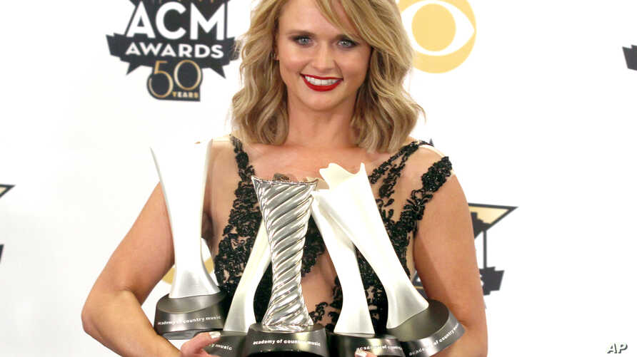 "Miranda Lambert poses in the press room with the milestone award and the awards for song of the year for ""Automatic"", album of the year for ""Platinum"" and female vocalist of the year at the 50th annual Academy of Country Music Awards at AT&T Stadium,..."