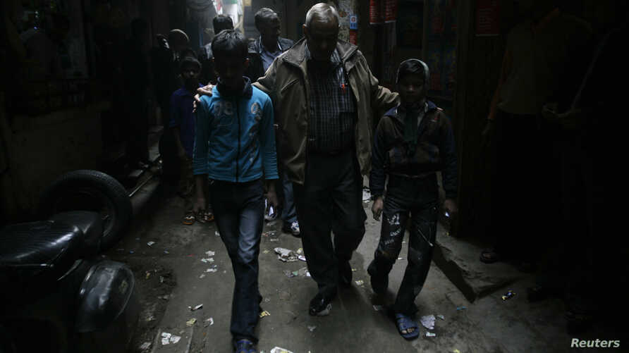 FILE - Bonded child labourers are escorted by a policeman (C) after they were rescued during a joint operation conducted by police and a non-governmental organisation (NGO) in New Delhi, December 10, 2009.