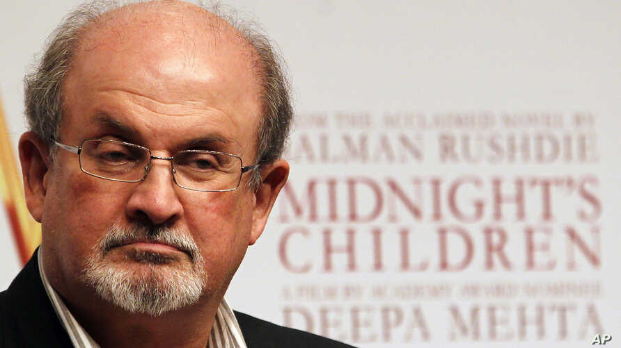 """FILE - Author Salman Rushdie, author of """"The Satanic Verses,"""" is seen at a promotional event in Mumbai, India, Jan. 29 , 2013."""
