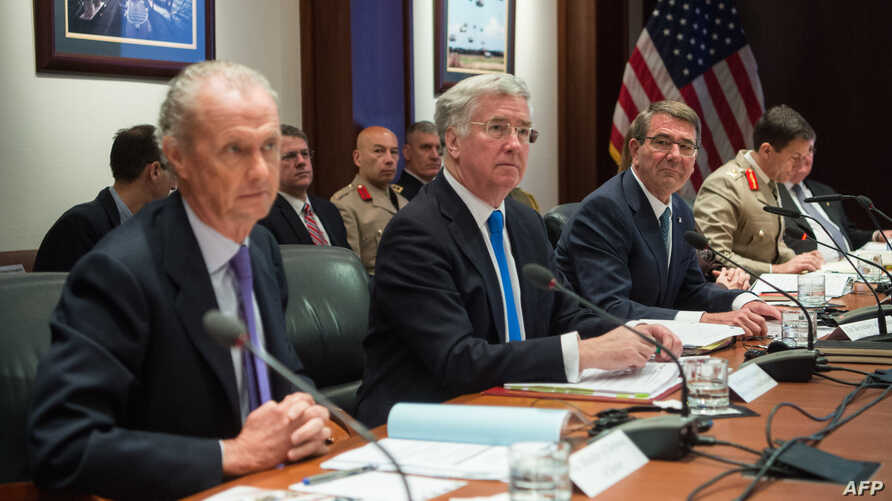 (L-R) Spain's Defence Minister Pedro Morenes, Britain's Secretary of State for Defence Michael Fallon and the United States Secretary of Defense Ashton Carter, along with (seen in the background) Britain's Major General Doug Chalmers and the Ambassad