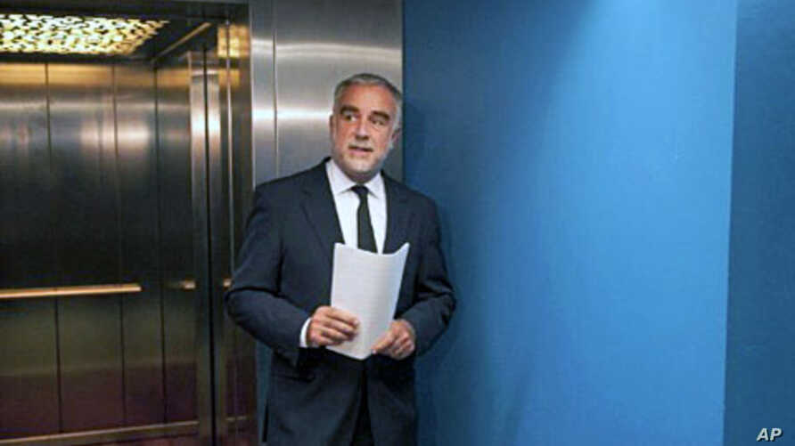 International Criminal Court (ICC) chief prosecutor Luis Moreno-Ocampo arrives to explain during a news conference at The Hague on May 16, 2011 his request for arrest warrants for Libyan leader Moamer Kadhafi, his son Saif al-Islam and the head of th
