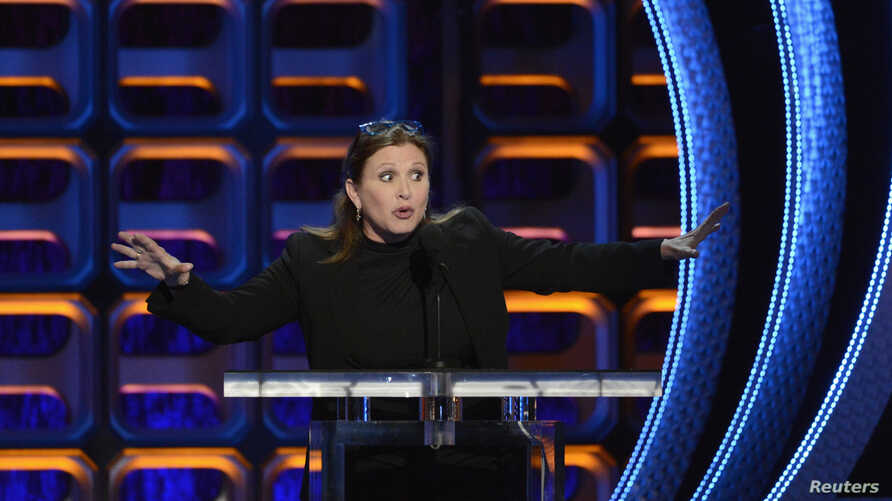 FILE - Carrie Fisher speaks during the taping of the Comedy Central Roast of Roseanne in Los Angeles, Aug. 4, 2012.