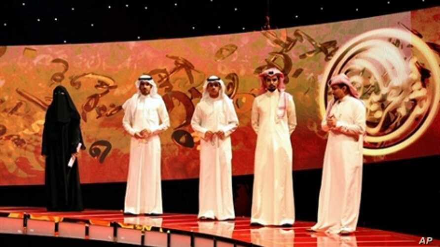 Saudi poet Hissa Hilal (L) stands next to the other contestants during the final episode of the talent show 'Million's Poet' in Abu Dhabi late on 07 Apr 2010