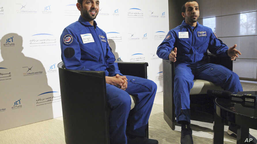 Emirati astronauts Sultan al-Neyadi, left, and Hazza al-Mansoori, are interviewed by The Associated Press in Dubai, United Arab Emirates, Monday, Feb. 25, 2019.