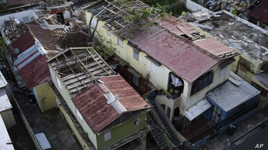Some roofs damaged by Hurricane Maria are still exposed to rainy weather in San Juan, Puerto Rico, Nov. 15, 2017. The Department of Homeland Security will investigate how a tiny Florida company won more than $30 million in contracts for desperately n