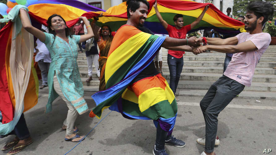 Members of the LGBT community dance to celebrate after the country's top court struck down a colonial-era law that made homosexual acts punishable by up to 10 years in prison, in Bangalore, India, Sept. 6, 2018.