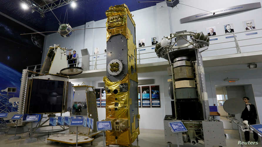 The Express-1000, from left, Glonas-K and Ekran-AM satellites are on display at the Educational and Demonstration center of the Siberian State Aerospace University to mark Cosmonautics Day on April 12, 2017, in the Siberian city of Krasnoyarsk, Russi
