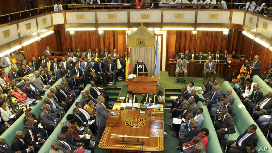 Uganda's Prime Minister, standing center-left, addresses Members of Parliament in Kampala, Uganda, Sept. 21, 2017.