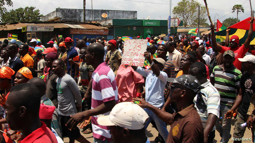 Opposition supporters take part during a protest calling for the immediate resignation of President Faure Gnassingbe in Lome, Togo, Sept. 20, 2017.