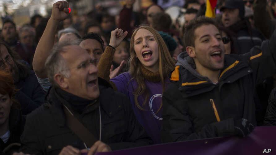 People shout slogans during a Podemos party march in Madrid, Spain, Jan. 31, 2015.