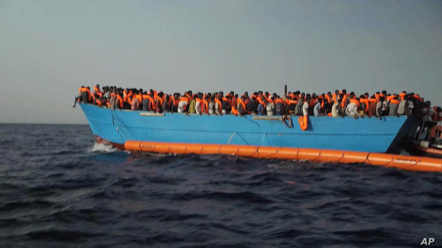 Migrants are crowded on to the vessel in the Mediterranean Sea off the coast of Libya in this Oct. 4, 2016 image taken from video.