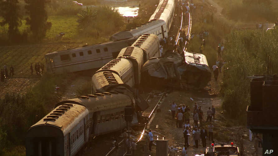 Cars from two passenger trains lie off the tracks after they collided just outside Egypt's Mediterranean port city of Alexandria, Aug. 11, 2017.