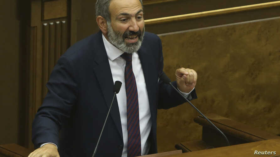 Armenian opposition leader Nikol Pashinyan addresses lawmakers during a parliament session to elect an interim prime minister in Yerevan, Armenia, May 1, 2018.