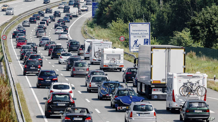 FILE - In this July 24, 2016 file photo drivers are stuck in a traffic jam on highway A 1  near to Bad Oldesloe in Germany.