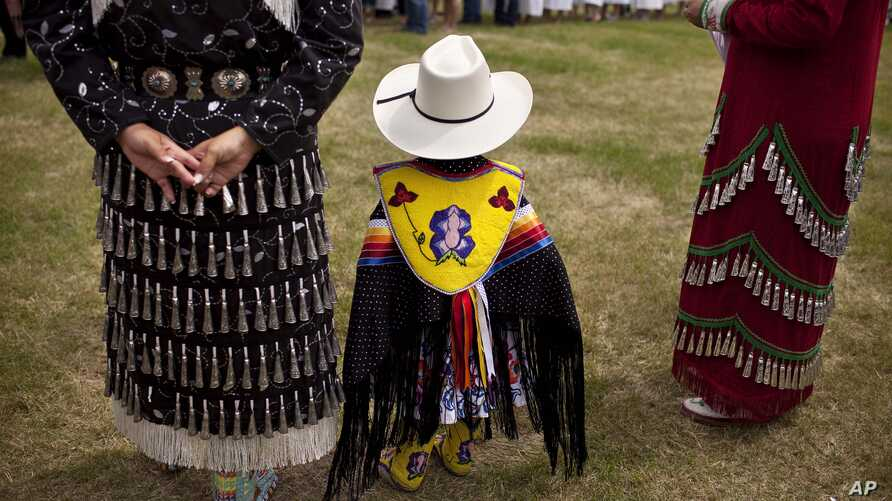 FILE - Traditional clothing is worn during an event to celebrate National Aboriginal Day in Winnipeg, Manitoba, June 23, 2011. More than 1 million Canadians are of Aboriginal origin, and the nation has more than 600 recognized First Nations governmen
