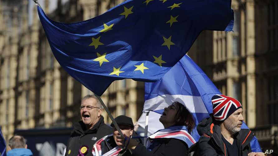 Anti-Brexit remain in the European Union supporters shout slogans during a protest outside the Houses of Parliament in London, March 14, 2019.