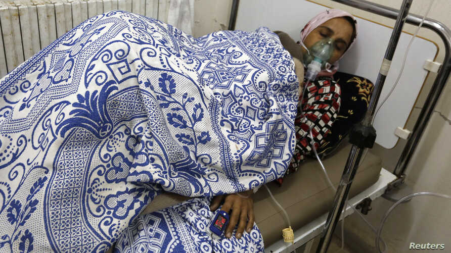 A woman, affected by what activists say was a gas attack, receives treatment inside a makeshift hospital in Kfar Zeita village in the central province of Hama May 22, 2014. Syrian opposition activists have posted a video of what they say is chlorine
