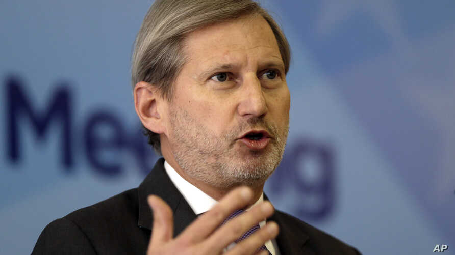 EU Commissioner for Enlargement and European Neighbourhood Policy Johannes Hahn addresses a journalist during a press conference marking the end of a summit of Western Balkan leaders in Sarajevo, Bosnia, March. 16, 2017.