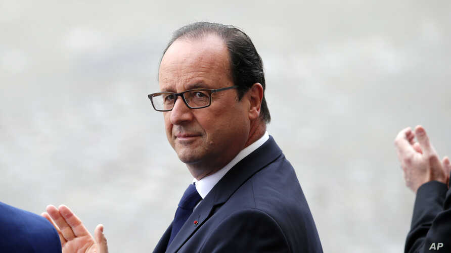 French President Francois Hollande attends the Bastille Day parade on in Paris, July 14, 2014.