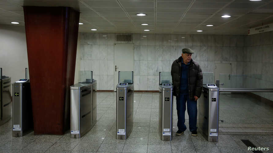 A man exits a metro station during a 24-hour strike in Athens, Greece, Jan. 12, 2018.
