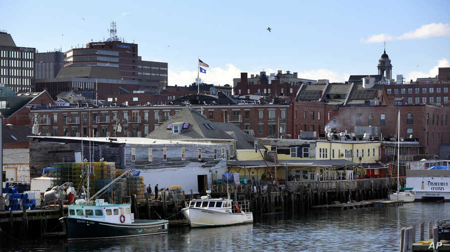 FILE -- Fishing boats are tied up at a wharf on the waterfront in Portland, Maine, on March 11, 2016.