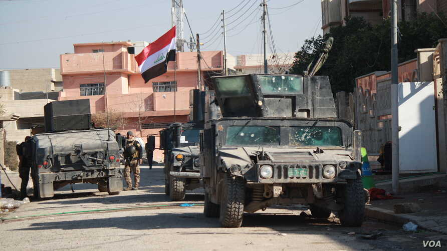 Iraqi forces say despite recent gains, they still struggle with IS attacks, which now include the deployment of drones armed with small bombs in Mosul, Jan. 11, 2017.