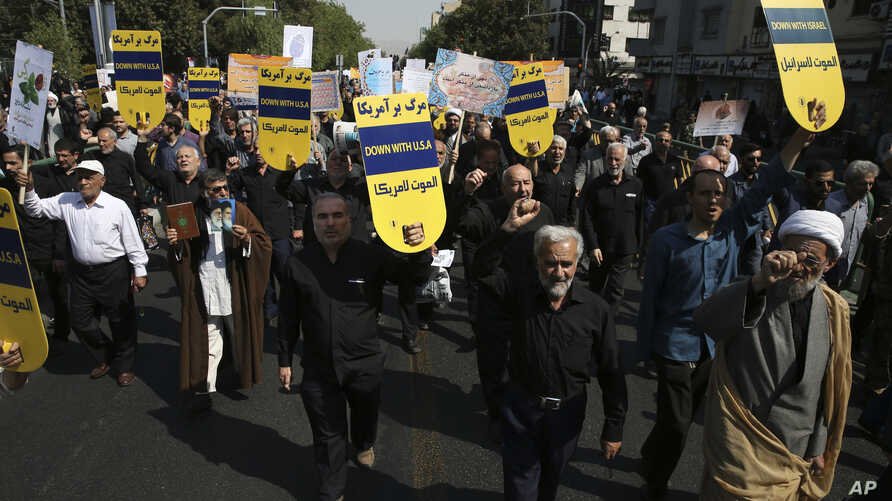 """Iranian protesters chant slogans in an anti-U.S. rally in Tehran, Iran, Sept. 22, 2017. The protesters condemned President Donald Trump's remarks at the United Nations, calling Iran a """"corrupt dictatorship"""" and a """"murderous regime,"""" and said the land"""