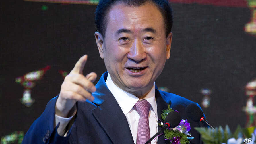 FILE - Wang Jianlin, chairman of Wanda Group, speaks during a signing ceremony for a strategic partnership between FIBA and Wanda Group in Beijing, June 16, 2016. Wanda Group has purchased Dick Clark Productions for $1 billion.