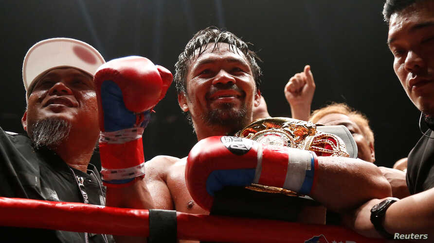 Manny Pacquiao celebrates after winning the WBA welterweight title fight against Argentinian Lucas Matthysse, July 15, 2018, in Kuala Lumpur, Malaysia.