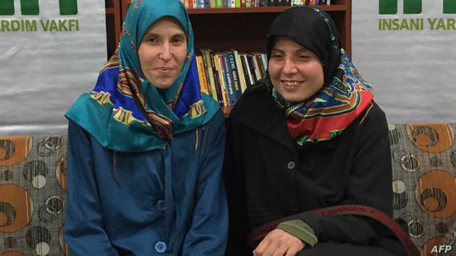 Two young Czech women, Antonie Chrastecka, left,  and Hana Humpalova, right, kidnapped in Pakistan in 2013 have been freed and have returned home, Prime Minister Bohuslav Sobotka said, March 28.