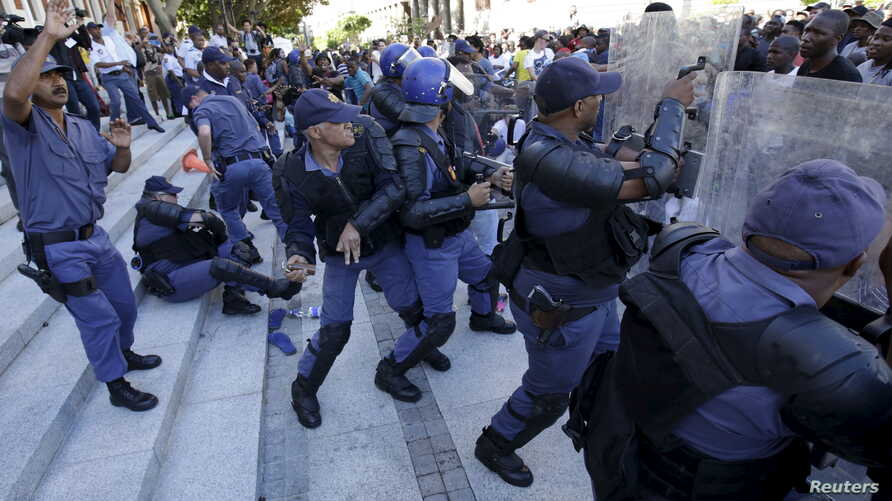 FILE - Police clash with protesters outside South Africa's Parliament in Cape Town, Oct. 21, 2015.