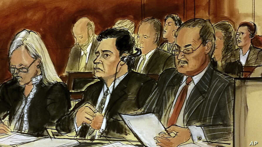 In this courtroom sketch, Mehmet Hakan Atilla, second from left, listens to the judge during his sentencing, flanked by his attorneys Cathy Fleming, left, and Victor Rocco, May 16, 2018, in New York. Atilla's wife, upper right in the sketch, also lis