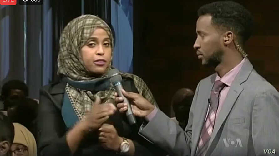"A moderator (R) and participant of VOA's Somali Service ""Mogadishu-Minnesota"" town hall meeting are seen in a screen grab from its Facebook stream."
