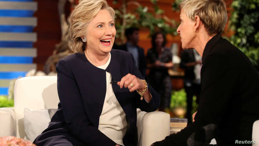US Democratic presidential nominee Hillary Clinton (L) chats with Ellen DeGeneres during a commercial break in taping of the Ellen Show in Burbank, Los Angeles, California, Oct. 13, 2016.