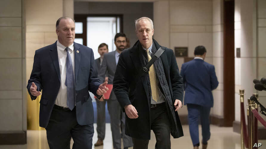 Rep. Dan Kildee, D-Mich (L), and Rep. Sean Patrick Maloney, D-N.Y., arrive for a classified security briefing on the murder of Jamal Khashoggi and Saudi Arabia's war in Yemen, on Capitol Hill in Washington, Dec. 13, 2018.