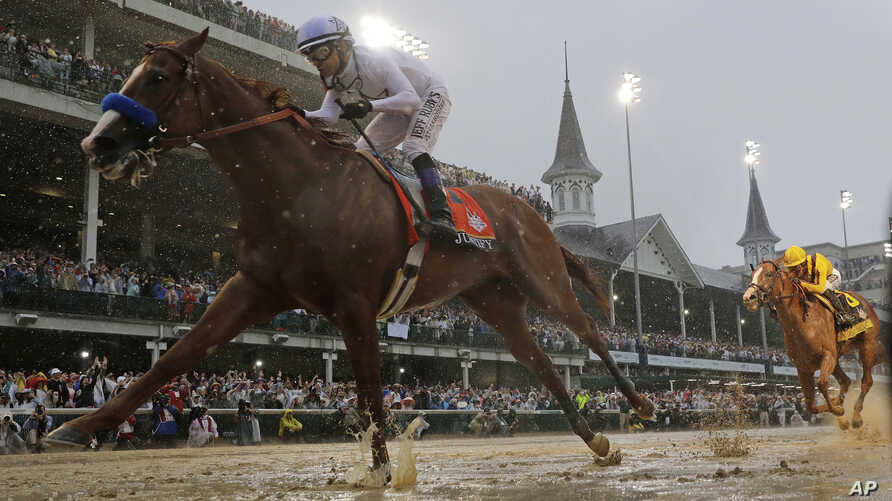 Mike Smith rides Justify to victory during the 144th running of the Kentucky Derby horse race at Churchill Downs, May 5, 2018, in Louisville, Ky.