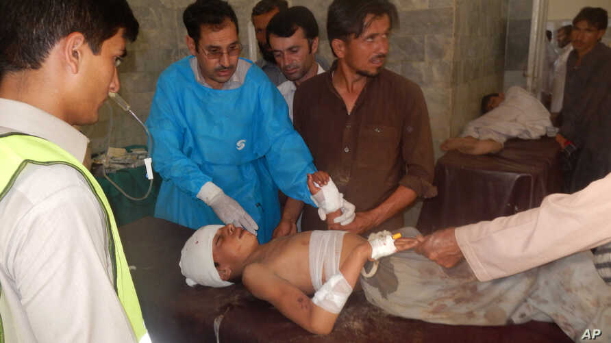 A Pakistani child who was injured in a suicide bombing is treated at a local hospital in Khar, Pakistan, Friday, Sept. 16, 2016. A suicide bomber attacked a Sunni mosque in northwest Pakistan on Friday, killing dozens of worshippers.
